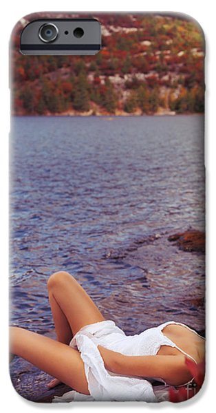 Seductive iPhone Cases - Young woman in white dress lying on lake shore iPhone Case by Oleksiy Maksymenko