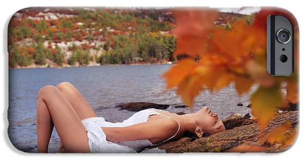 Seductive iPhone Cases - Young woman in white dress lying on shore of lake in fall iPhone Case by Oleksiy Maksymenko