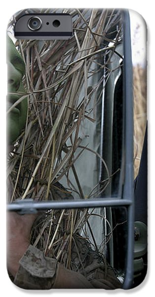 A Scout Observer Applies Camouflage iPhone Case by Stocktrek Images