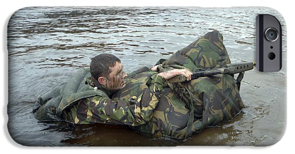 Physical Exhaustion iPhone Cases - A Soldier Participates In A River iPhone Case by Andrew Chittock