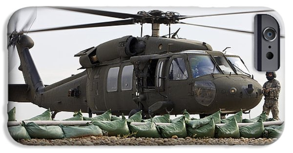 Iraq iPhone Cases - Balad, Iraq - A Uh-60l Black Hawk Lands iPhone Case by Terry Moore