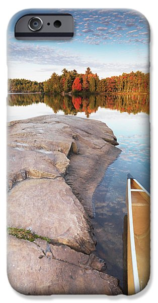 Canoe iPhone Cases - Canoe at a Rocky Shore Autumn Nature Scenery iPhone Case by Oleksiy Maksymenko