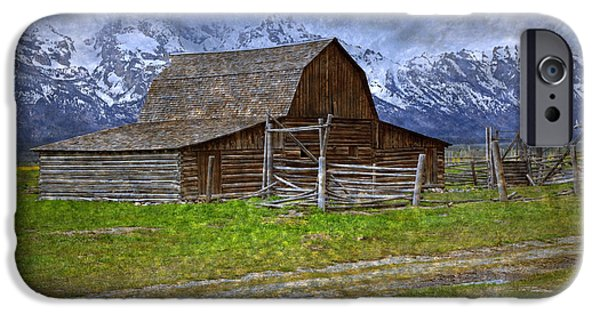 Pioneer Scene iPhone Cases - Grand Teton Iconic Mormon Barn Fence Spring Storm Clouds iPhone Case by John Stephens
