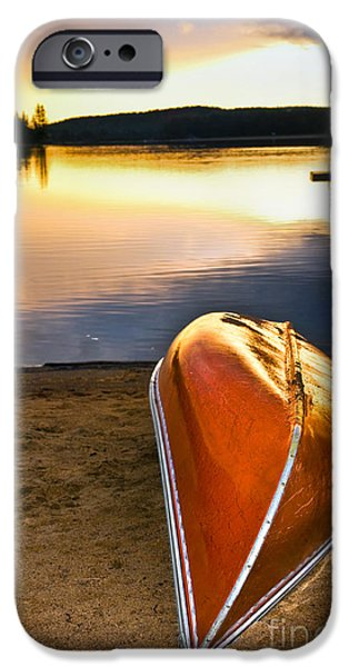 Algonquin iPhone Cases - Lake sunset with canoe on beach iPhone Case by Elena Elisseeva