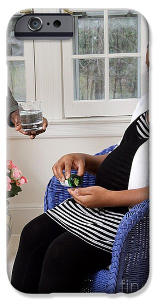 African American Diet iPhone Cases - Pregnant Woman Taking Vitamins iPhone Case by Photo Researchers