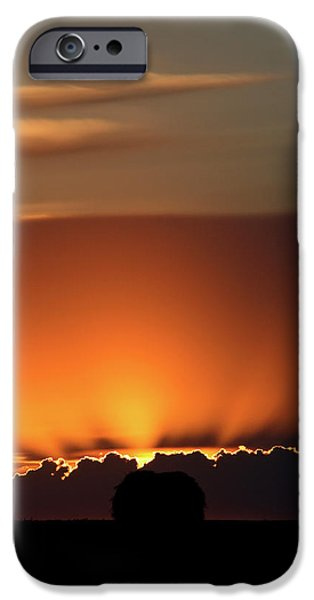 Sun Flare iPhone Cases - Setting sun peaking out from storm clouds in Saskatchewan iPhone Case by Mark Duffy