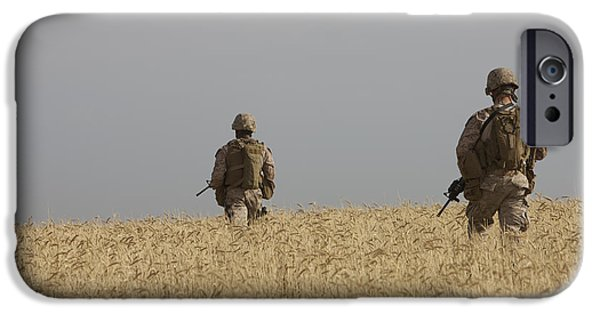Agriculture iPhone Cases - U.s. Marines Patrol A Wadi Near Kunduz iPhone Case by Terry Moore