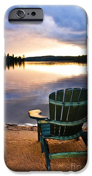 Beach Landscape iPhone Cases - Wooden chair at sunset on beach iPhone Case by Elena Elisseeva