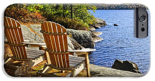 Chair iPhone Cases - Adirondack chairs at lake shore iPhone Case by Elena Elisseeva