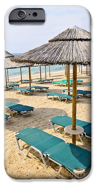Beach umbrellas on sandy seashore iPhone Case by Elena Elisseeva