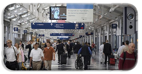 United Airlines Passenger Plane iPhone Cases - Busy airport terminal concourse at Chicagos OHare airport iPhone Case by Christopher Purcell