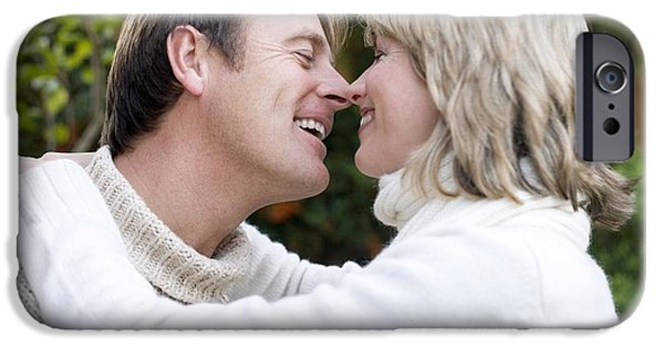 Women Together iPhone Cases - Smiling Couple Embracing iPhone Case by Ian Boddy