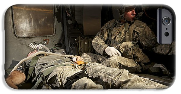 Medical Equipment iPhone Cases - U.s. Army Specialist Practices Giving iPhone Case by Terry Moore