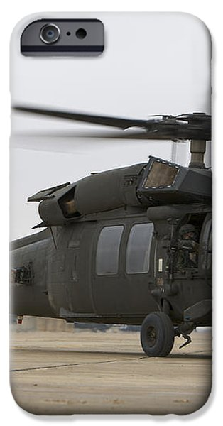 A Uh-60 Black Hawk Taxis iPhone Case by Terry Moore
