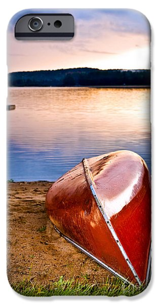 Canoes iPhone Cases - Lake sunset with canoe on beach iPhone Case by Elena Elisseeva