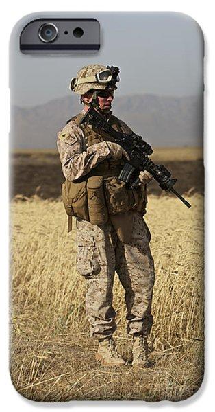 U.s. Marine Patrols A Wadi Near Kunduz iPhone Case by Terry Moore