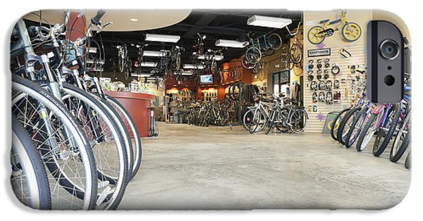 Weekend Activities iPhone Cases - Bicycles And The Servicesales Desk iPhone Case by Roberto Westbrook