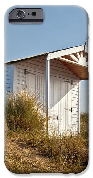 A Beach hut in the Marram Grass at Old Hunstanton North Norfolk iPhone Case by John Edwards