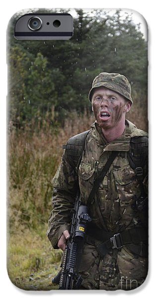 Physical Exhaustion iPhone Cases - A British Soldier During Exercise iPhone Case by Andrew Chittock