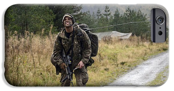 Physical Exhaustion iPhone Cases - A British Soldier With Radio iPhone Case by Andrew Chittock