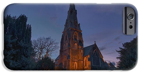 Headstones iPhone Cases - A Cemetery And Church Building iPhone Case by John Short