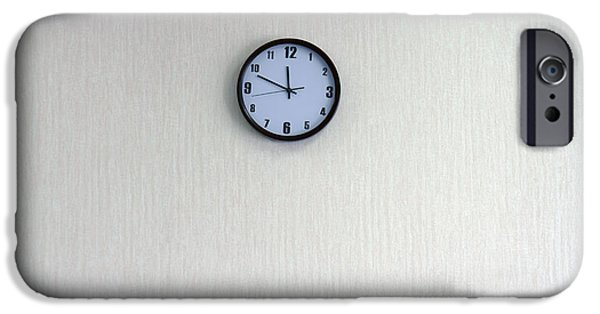 Work Tool iPhone Cases - A Clock With A Blue Face On The Wall iPhone Case by Guang Ho Zhu