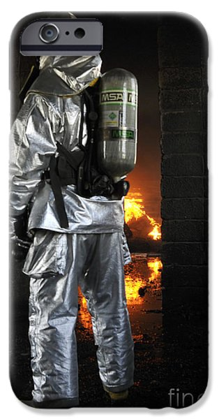 Baghdad iPhone Cases - A Firefighter Waits For A Fire To Get iPhone Case by Stocktrek Images