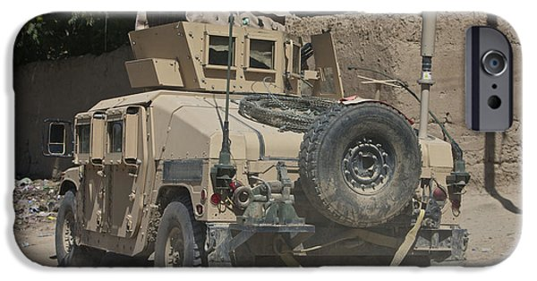 East Village iPhone Cases - A Humvee Patrols The Streets Of Kunduz iPhone Case by Terry Moore
