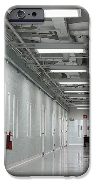 A Long Corridor In A Residential Unit iPhone Case by Roberto Westbrook