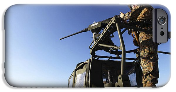 Copy Machine iPhone Cases - A Machine Gunner Mounts A M-2 iPhone Case by Stocktrek Images