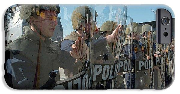 Law Enforcement iPhone Cases - A Riot Control Team Braces iPhone Case by Stocktrek Images