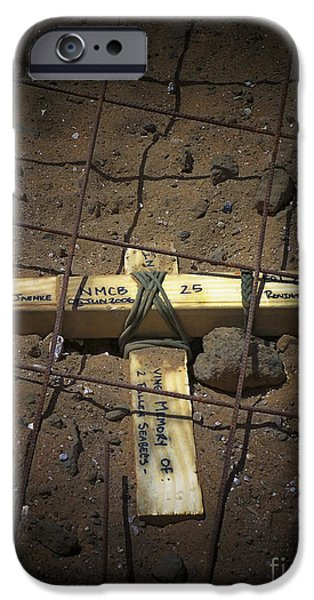 Graveyard Road iPhone Cases - A Road Repair Crew Places A Cross iPhone Case by Stocktrek Images