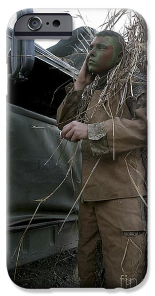 Observer iPhone Cases - A Scout Observer Applies Camouflage iPhone Case by Stocktrek Images