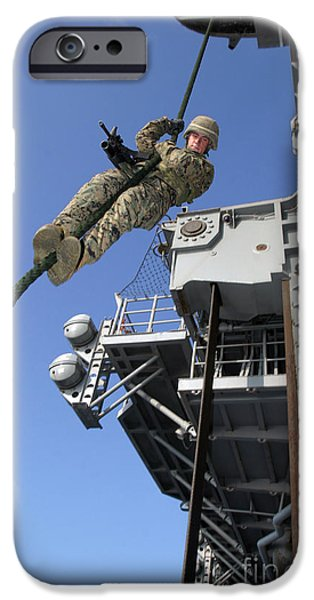 A Soldier Fast-ropes From The Rear iPhone Case by Stocktrek Images