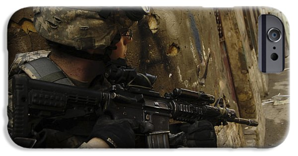 Baghdad iPhone Cases - A U.s. Army Soldier Providing Security iPhone Case by Stocktrek Images