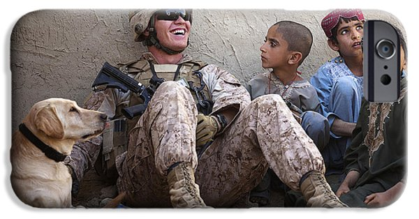 East Village Photographs iPhone Cases - A U.s. Marine Jokes With Afghan iPhone Case by Stocktrek Images