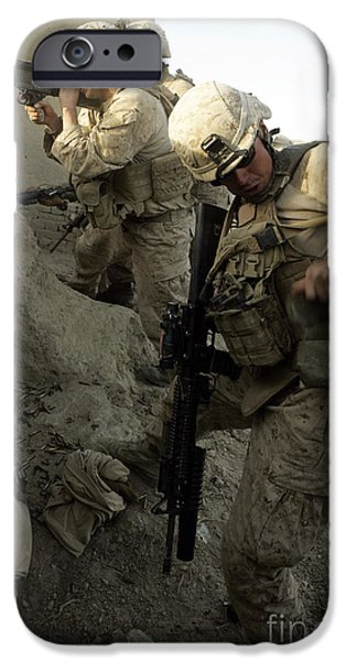 Fed iPhone Cases - A U.s. Marine Reaches For More Rounds iPhone Case by Stocktrek Images