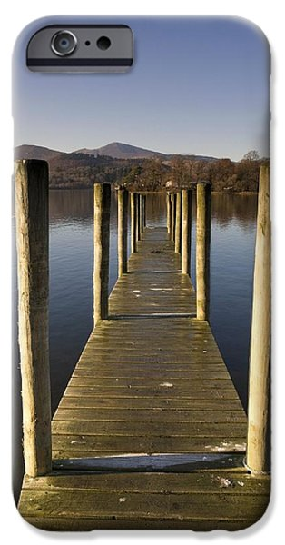 Trees Reflecting In Water iPhone Cases - A Wooden Dock Going Into The Lake iPhone Case by John Short