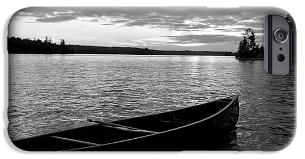Absence iPhone Cases - Abandoned Canoe Floating On Water iPhone Case by Keith Levit