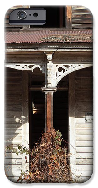 Abandoned House Facade Rusty Porch Roof iPhone Case by John Stephens