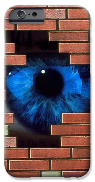 Abstract Of Eye Looking Through Hole In Brick Wall iPhone Case by Mehau Kulyk