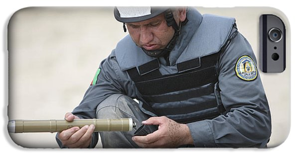 Police Officer iPhone Cases - Afghan Police Student Prepares iPhone Case by Terry Moore