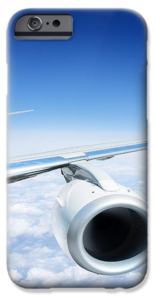 Airliner In Flight Above The Clouds iPhone Case by Corepics