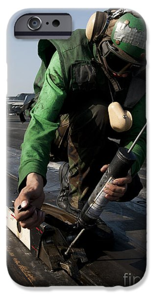 Freedom iPhone Cases - Airman Greases The Catapult Shuttle iPhone Case by Stocktrek Images