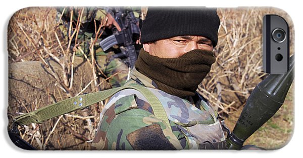 Rpg iPhone Cases - An Afghan Commando On Patrol iPhone Case by Stocktrek Images