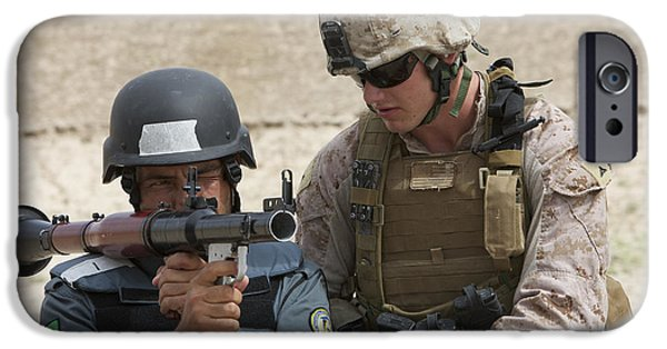 Rpg iPhone Cases - An Afghan Police Student Aiming A Rpg-7 iPhone Case by Terry Moore