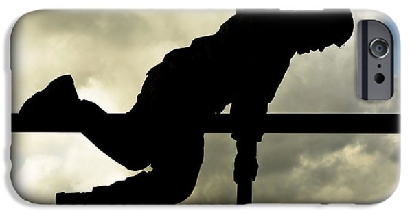 Bullis iPhone Cases - An Airman Scales An Obstacle At Camp iPhone Case by Stocktrek Images
