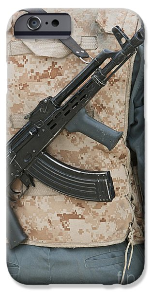 Police Officer iPhone Cases - An Ak-47 Rests On The Sling Of An iPhone Case by Terry Moore