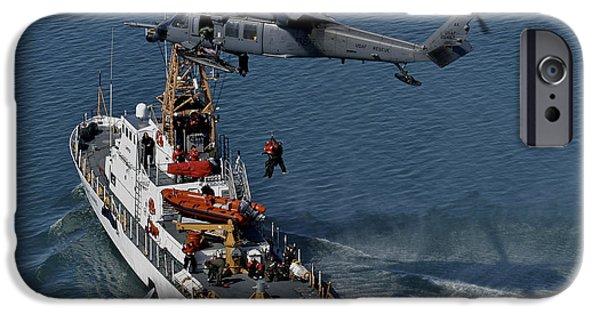 Law Enforcement iPhone Cases - An Hh-60g Pave Hawk Performs A Hoist iPhone Case by Stocktrek Images