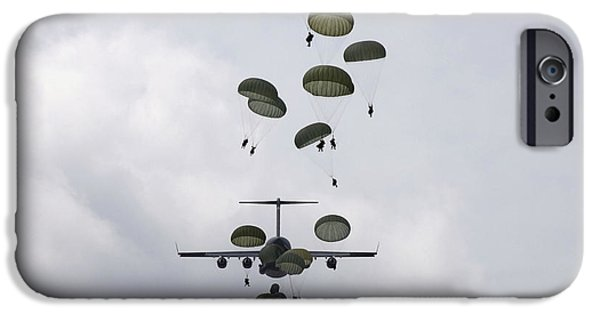 Military Airplanes iPhone Cases - Army Soldiers Jump Out Of A C-17 iPhone Case by Stocktrek Images